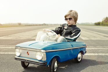 Cool boy in pedal car on race track - EDF000179