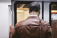 Back view of man on the subway train - EBSF000492