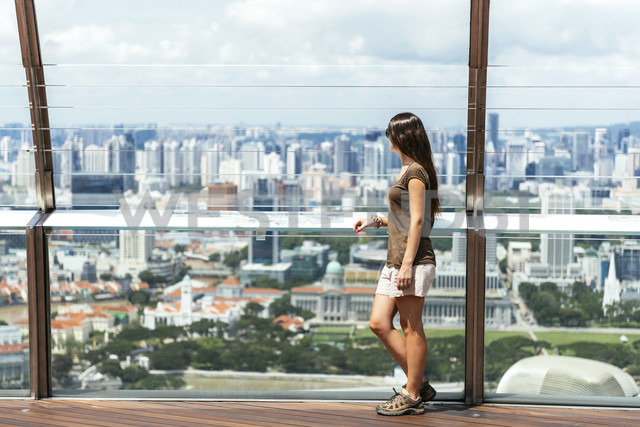 Singapore, woman standing on observation deck of Sands SkyPark looking at view - GEM000167