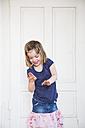 Girl dancing at wooden door - LVF003157