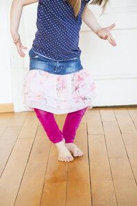 Girl dancing on wooden floor - LVF003158