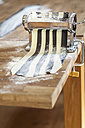 Making striped pasta in pasta machine, partly colored with cuttlefish ink - SBDF001765