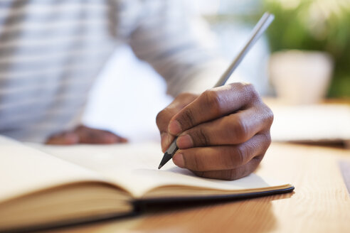 Man's hand drawing in a notebook - EBSF000544
