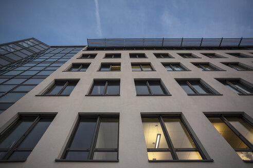 Germany, Munich, facade of office building at evening twilight - ZMF000381