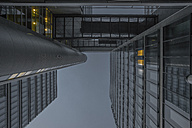 Germany, Munich, facades of office tower at evening twilight - ZMF000383