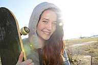 Portrait of smiling female skate boarder - BFRF001075