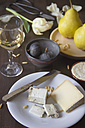 Variety of cheese, wine, pears, figs and pine nuts - YFF000358