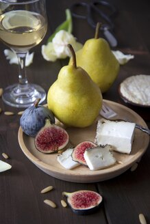 Variety of cheese, wine, pears, figs and pine nuts - YFF000360