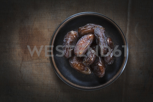 Bowl of Medjooll dates on wood - EVGF001544
