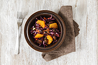 Bowl of red cabbage salad with orange slices, carrots and dates - EVGF001555