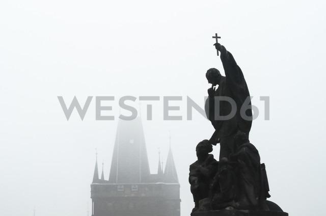 Czech Republic, Prague, statue on Charles Bridge in morning fog - HAMF000032
