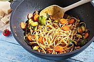 Preparing Spaghetti Bolgnese in a wok - CSF025279