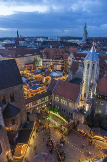 Germany, Braunschweig, view to lighted Christmas market at blue hour from above - PVC000387