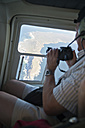 South Africa, Cape Point, man inside of a helicopter flying over Cape of Good Hope - CLP000080