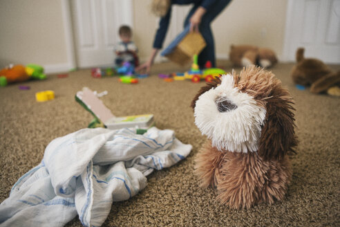Toy dog and cloth on the floor of nursery - SELF000042