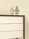 Male and female robot on sideboard, 3D rendering - UWF000424
