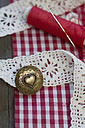 Cotton reel, sewing needle, lace and metal button with heart - CRF002674