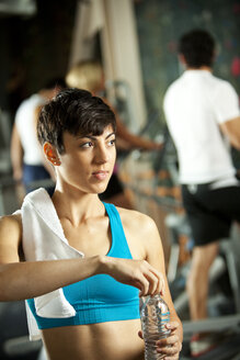 Woman with bottle of water in a gym - SELF000050