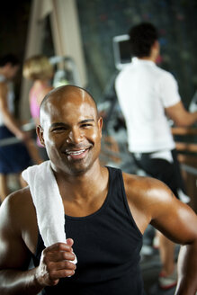 Portrait of smiling man in a gym - SELF000052