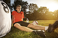 Two soccer players on soccer pitch having abreak - GCF000063