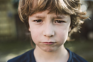 Portrait of little boy pouting mouth - RAEF000134