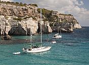 Spain, Balearic Islands, Menorca, Two yachts anchored at the entrance to Cala Macarella - RAE000136