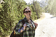 Spain, Catalonia, smiling woman with backpack hiking in the Pyrenees - GEMF000207