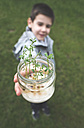 Boy holding jar with sprouted seeds - DEGF000402