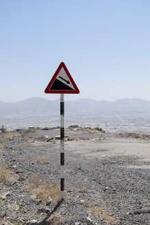 Oman, Warning sign for downward slope - HLF000864