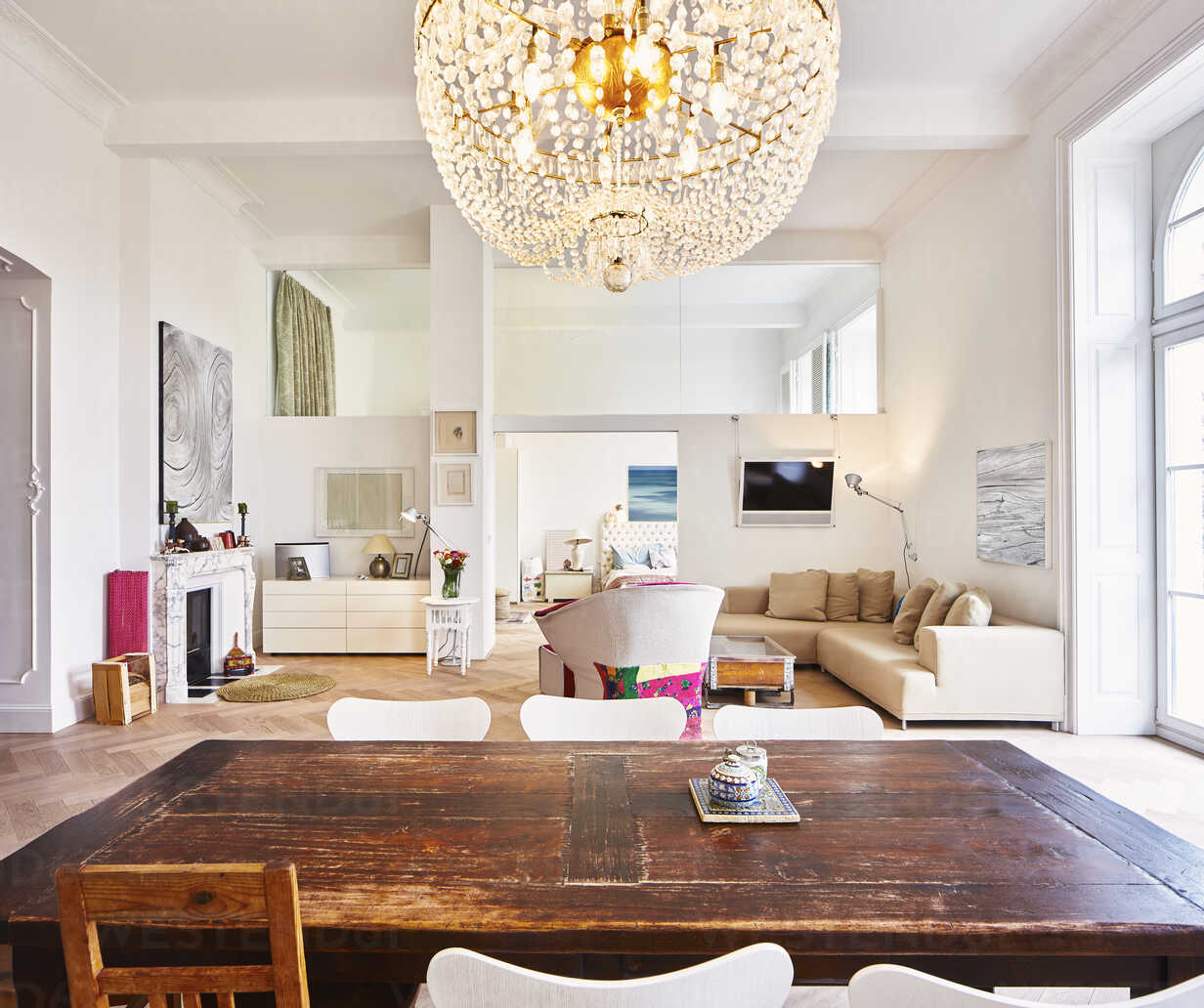 Living room in a refurbished old building with dining table in the foreground - DISF002034 - Dieter Schewig/Westend61
