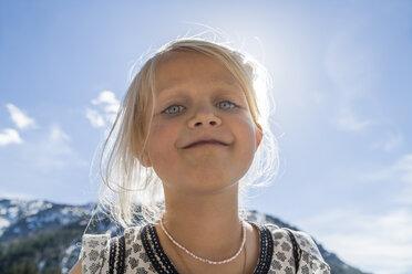 Austria, Tyrol, Lake Plansee, portrait of smiling girl - TCF004624