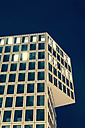 Germany, Stuttgart, office building with some lighted windows in the evening - WDF003077