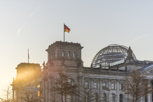 Germany, Berlin, Berlin-Tiergarten, Reichstag building against the sun in the morning - PVCF000416