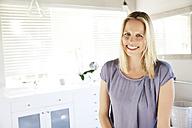 Blonde woman standing in bathroom - TOYF000115