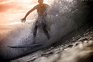 Indonesia, Lombok Island, surfing man at backlight - KNTF000013