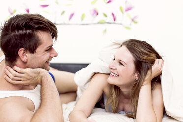 Couple lying in bed having fun - DAWF000347