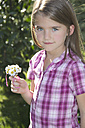 Portrait of little girl with bunch of daisys - YFF000412