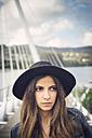 Spain, Ferrol, portrait of young woman wearing black hat - RAEF000148