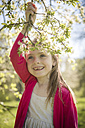 Portrait of smiling girl holding blossoming twig - SARF001741