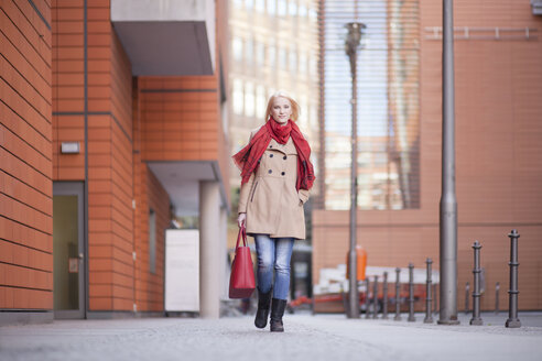 Young woman with red scarf and red leather bag - MMFF000833