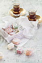 Two glasses of Turkish black tea and sweets - SBDF001788