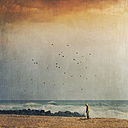France, Contis-Plage, man standing alone at beach - DWI000478
