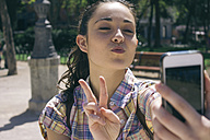 Young woman taking a selfie with smartphone - ABZF000011