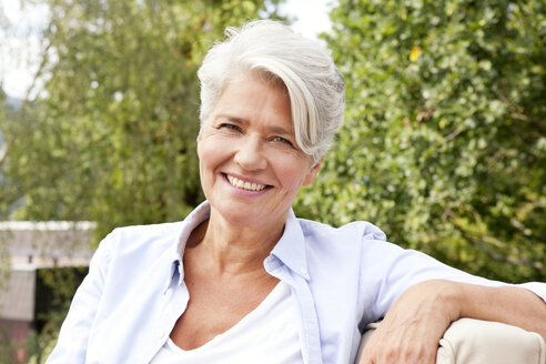 Portrait of smiling mature woman outdoors - MFRF000157