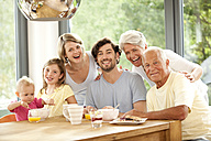 Portrait of happy extended family at breakfast table - MFRF000217