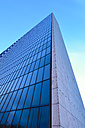 Germany, Hamburg, glass facade of an office building - RJF000428