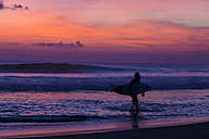 Indonesia, Bali, Surfer at sunset - KNTF000030
