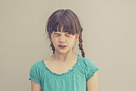 Portrait of girl squinting her eyes - LVF003237