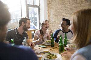 Happy friends eating together - FKF000959