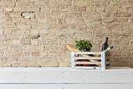 Wooden box with vegetables, pasta, baguette, basil and wine bottle - FKF001032